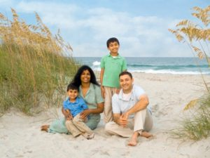 Family photo on the beach mother father two children ocean portrait Jonathan Starling